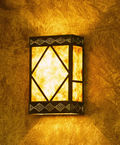 BWL; copper wall fixture with decorative punch patterns and natural mica diffuser
