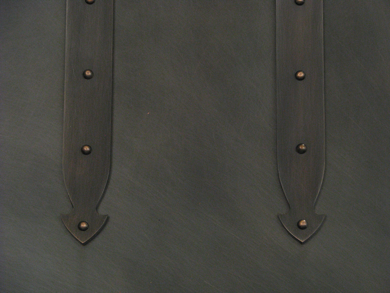 "Range Hood 4M detail - copper ""steamer trunk"" straps with ½"" decorative rivets and arrowhead ends, in Dark Copper finish"