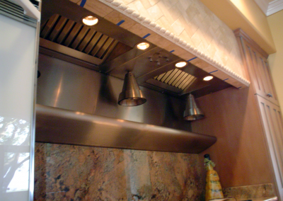Custom stainless steel insert with hanging heat lamps.