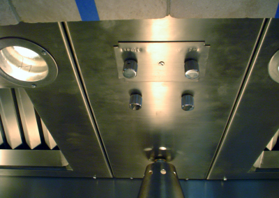 Custom stainless steel insert: Dual remote, inline fans with speed control. Dimmer switches for the heat lamps and the recessed MR16 lighting.