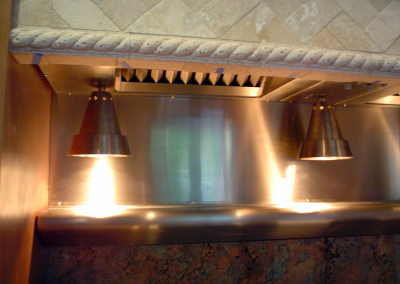 Custom stainless steel insert with hanging heat lamps. Randomly brushed stainless steel.