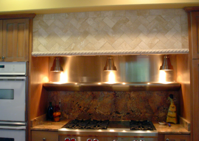 Custom stainless steel insert with 3 hanging heat lamps. Randomly brushed stainless steel.