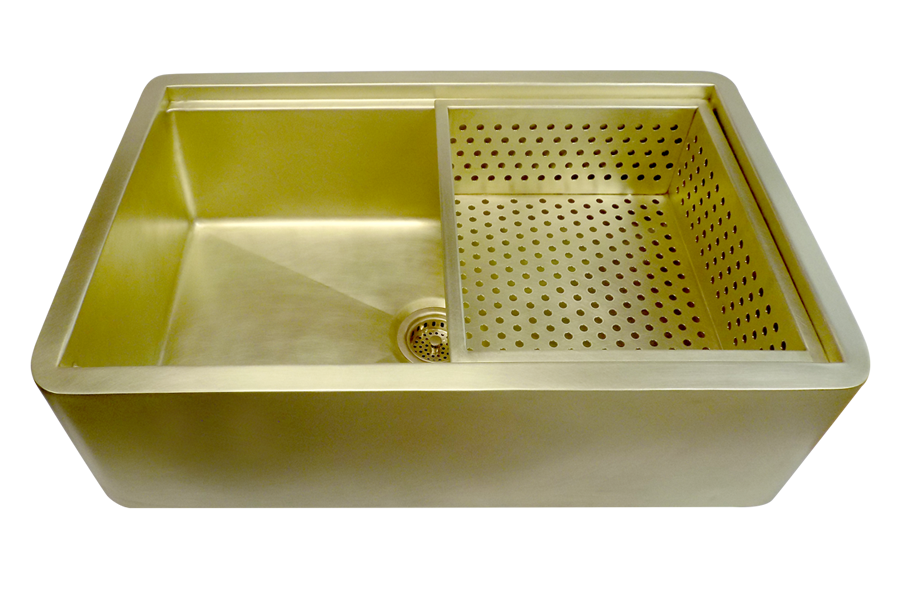 Brass Vegetable colander fits over sink flange.