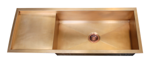 Custom bronze sink with integrated drain board