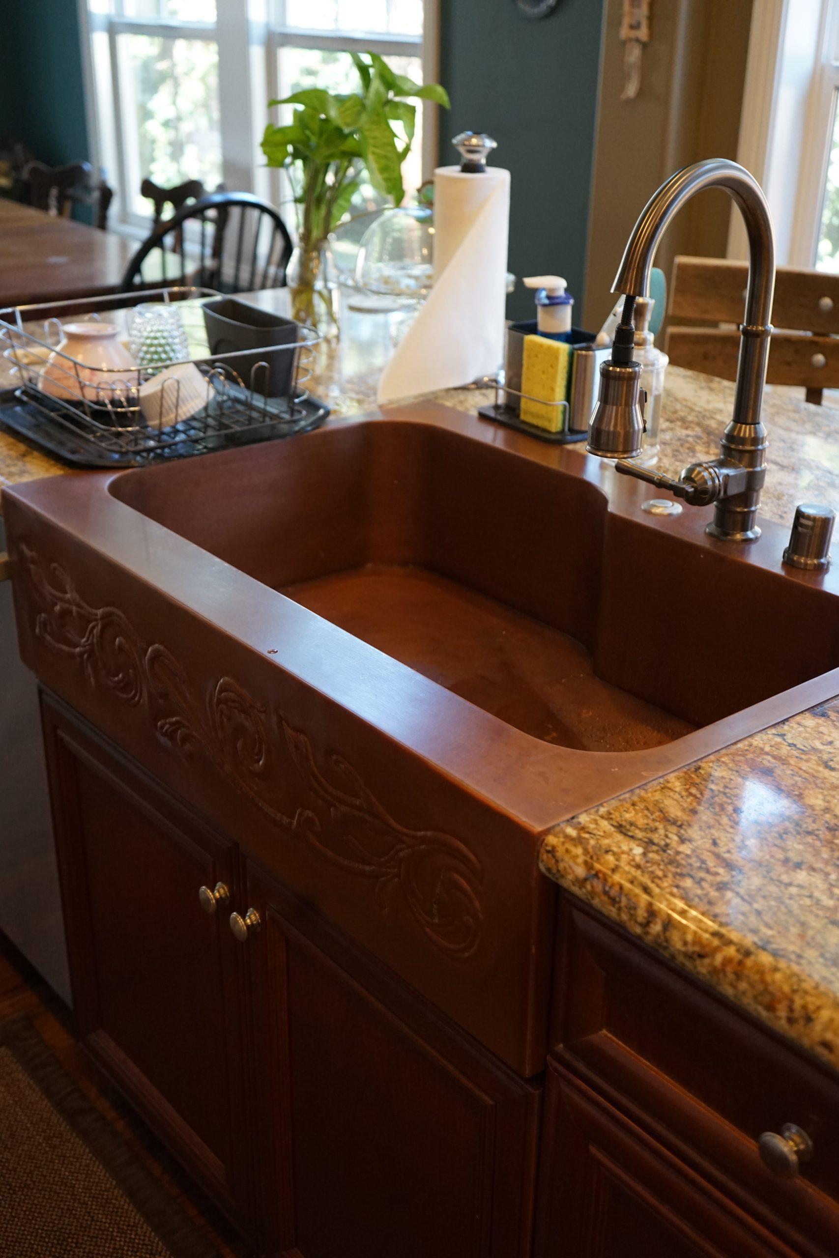 Offset Basin Farmhouse Sink with custom repoussé apron