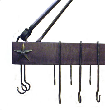 detail of wrought iron hanging pot rack with 3d star